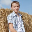 Cute boy on a background of rural - Stock Photo