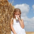 Blond girl drinking milk - Stock Photo