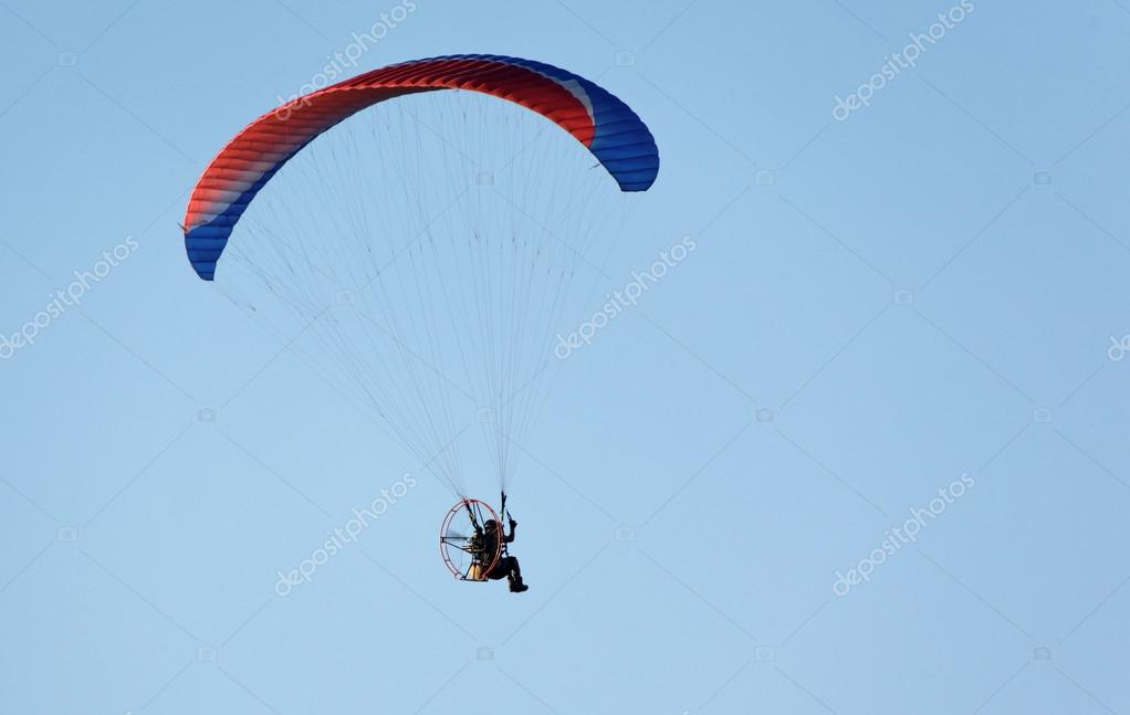 Paratrooper flying in the blue sky  Stock Photo #13610015