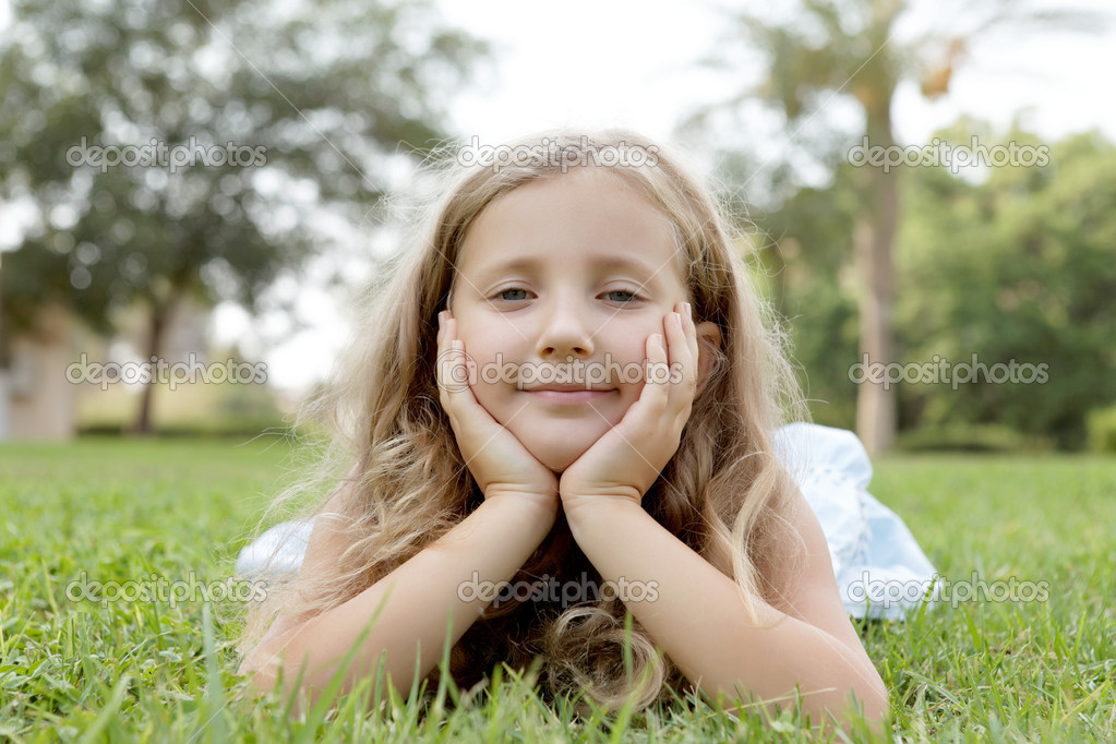 Happy blond child girl on nature — Stock Photo #13667679