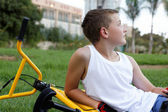 Boy with a bicycle outside — Stockfoto
