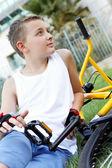 A boy and a bike outside — Stock Photo