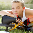 Sport boy with a bicycle outside — Stock Photo