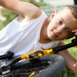 Boy rests with the bike — Stock Photo