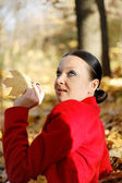 Pretty girl relax in autumn leaves — Stock Photo