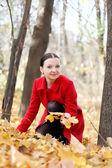 Pretty girl in red coat autumn — Foto Stock