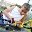 Cute boy with his bicycle outside — Stock Photo