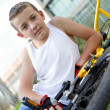 Pretty boy with his bicycle outside — Stock Photo