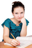 Pretty girl writes — Stock Photo