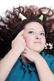 Pretty young girl with chic hair and horns — Stock Photo