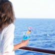 Pretty girl enjoys traveling on a ship — Stock Photo #14399509
