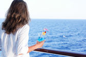 Pretty girl enjoys traveling on a ship — Stock Photo