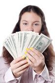 Cute brunette girl considers money — Stock Photo