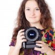 A pretty girl with camera isolated — Stock Photo