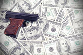 Gun on the money — Stock Photo