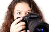 Curly girl with camera isolated — Stock Photo