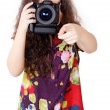 Pretty girl takes a camera — Stock fotografie