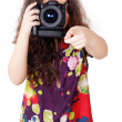 Pretty girl takes a camera — Stok fotoğraf