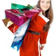 Royalty-Free Stock Photo: Cute girl dressed as Santa brings gifts