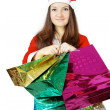 Pretty teen lady dressed as Santa with presents — Stock Photo