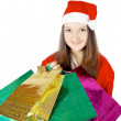 Cute teen girl dressed as Santwith presents — Stockfoto #15434343