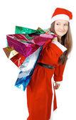 Söt flicka klädd som santa ger gåvor — Stockfoto