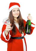 Cute teen girl dressed as Santa with champagne — Stock Photo