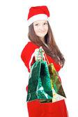 Hezká dívka, oblečený jako santa dává dárky — Stock fotografie