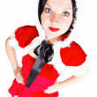 Pretty girl posing in Santa Christmas costume — Stock Photo