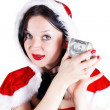 Girl with money in Santa suit — Stock Photo