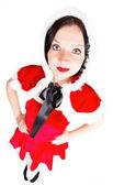 Söt flicka poserar i santa jul kostym — Stockfoto