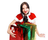 Brunette girl with presents for Christmas — Stock Photo