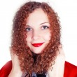 Portrait of pretty curly girl dressed as Santa — Stock Photo