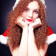 Pretty curly girl in a Santa suit — Stock Photo #15779179