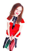 Pretty girl as Santa with shopping — Stock Photo