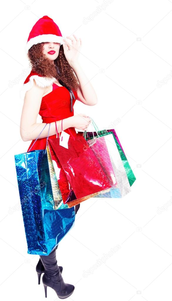 Cute long-legged girl as Santa with shopping on an isolated — Stock Photo #15779529