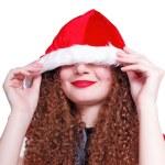 Pretty curly snow maiden hiding Christmas — Stock Photo #15836135