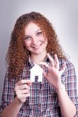 Curly girl builder with their dream house — Stock Photo