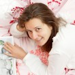 Portrait of a woman in bed — Stock Photo