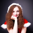 Pretty curly girl in Santa — Stock Photo