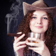 Pretty curly girl in a cowboy hat — Stock Photo