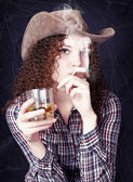 Pretty curly girl the cowboy — Stock Photo