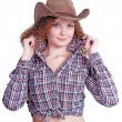 Cute curly girl in a cowboy hat — Stock Photo