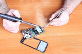 Repair broken cell phones — Stock Photo