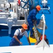 Workers at stern of liner — Stock Photo #27499589