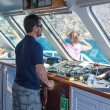 SANTORINI  GREECE  4 JULY 2012 skipper, in the workplace, steers the ship. — Stock Photo