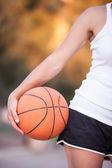 Girl with a basketball ball — Stock Photo