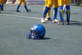 Helmet player in college football — 图库照片
