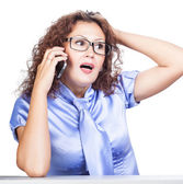 Interrogative emotion girl in the office — Stock Photo