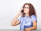 Pretty girl talking on the phone — Stock Photo